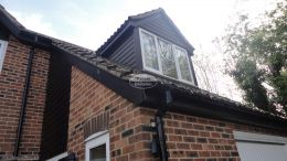 Black ash cladding replacement with new fascias, soffits and guttering