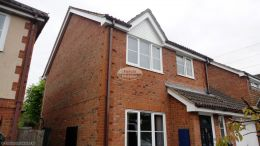 UPVC white herringbone cladding, white UPVC fascias and soffits with brown square guttering