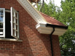Decorative fascia with black UPVC Ogee guttering