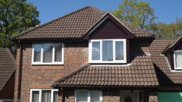 Rosewood UPVC shiplap cladding, fascias, soffits with UPVC brown guttering