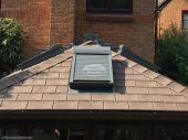 New conservatory roof with Velux roof windows and Velux roller shutters