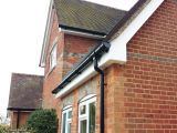 white fascia soffit black round guttering replacement