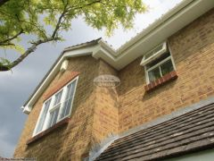 White tongue and groove soffit installation