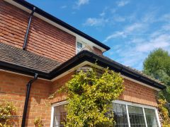Black Ash Fascia Replacement White Soffit With Black Half Round Guttering On A Character Property In Guildford