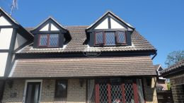 Installation black ash fascias soffits black guttering cladding Southwater