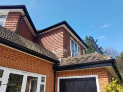 Recent Installtion Of Black Ash Fascias White Soffits And Guttering With Black Half Round Guttering Guildford
