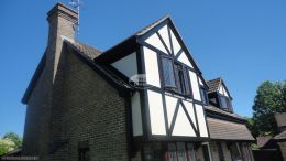 Recent installation of black ash fascias soffits guttering tudor beams Southwater