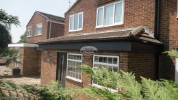 Full replacement fascias soffits and guttering with anthracite grey UPVC on detached property in Camberley