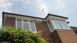 Installation of UPVC white fascias soffits and black half round guttering Chobham Guildford