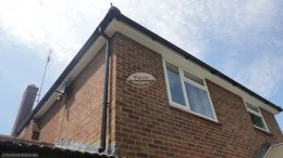 Installation of UPVC white fascias soffits and black half round guttering at rear of property Chobham Guildford
