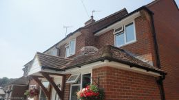 Installation of UPVC white fascias soffits and black half round guttering at rear of property Godalming Guildford