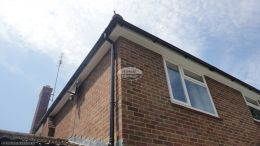 New UPVC white fascias soffits and black half round guttering on a detached property in Chobham Guildford