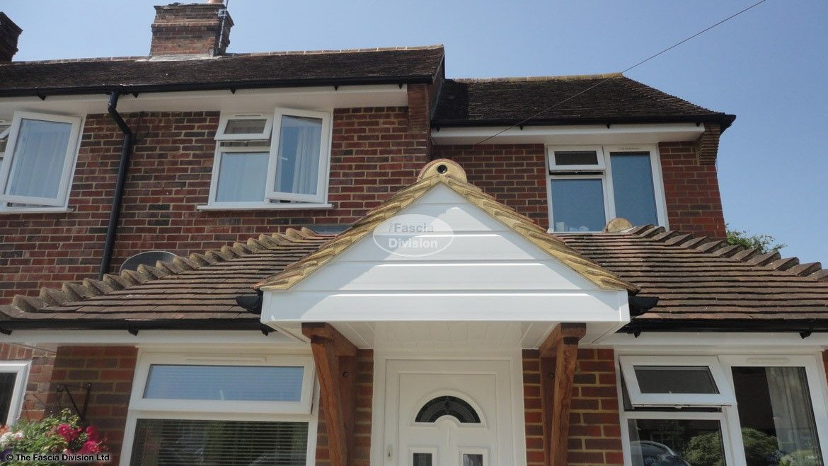 New UPVC white fascias tongue and groove soffits and black half round guttering on a detached property in Godalming Guildford