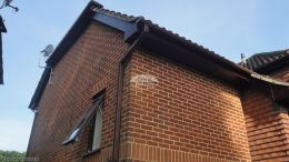 Recent installation of rosewood UPVC fascias soffits gable end and brown square line guttering at side of a semi detached property Bordon