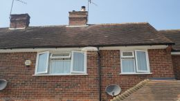 Replacement of UPVC white fascias soffits and black half round guttering Godalming Guildford