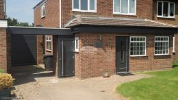 Replacing fascias soffits and guttering using UPVC anthracite grey on a detached property Camberley