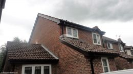 New UPVC rosewood fascia soffit and black square line guttering replacement on a detached property Godalming Guildford
