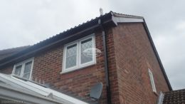 Replacement rosewood fascia soffit and black square line guttering on a detached property Godalming GuildfordReplacement rosewood fascia soffit and black square line guttering on a detached property Godalming Guildford