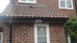 Replacement rosewood fascia soffit and black square line guttering on lower elevation Godalming Guildford