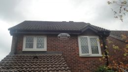 Replacement rosewood fascia soffit and guttering on a detached property Godalming Guildford