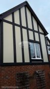 Installation of new mock tudor beams with cream composite render panels