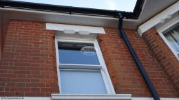 White hollow soffit white ogee fascia black gutters