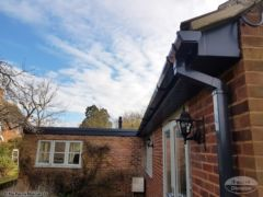 Anthracite grey fascias, soffits, square guttering and new grp flat roof