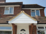 UPVC shiplap cladding on the lower elevation detached property in Godalming Guildford