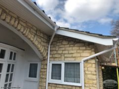 Cement gable end tiles UPVC fascia and guttering