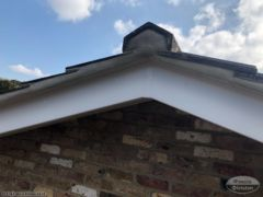 Repoint tiles on gable end and install new UPVC bargeboards
