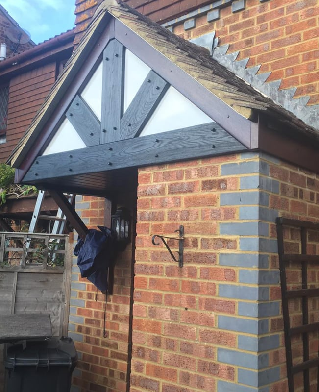 Rosewood fascia with Replica Wood mock Tudor beams on a porch