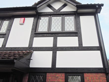Black tudor board with white render board replacement